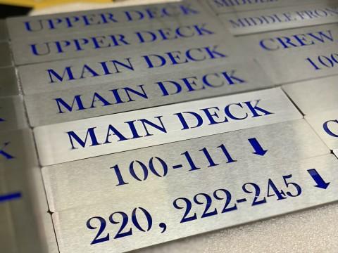 Инжиниринговые услуги по реставрации информационных табличек на корабле - лазерная резка, гравировка и сборка