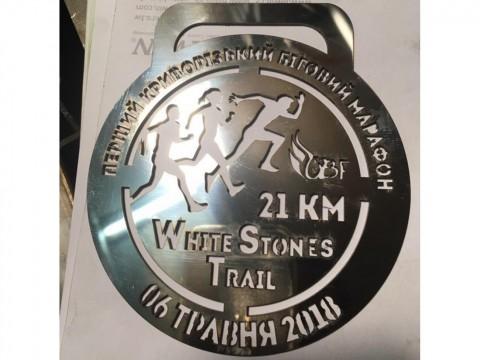 Лазерная резка медалей для участников и победителей марафона из стали марки СТ3 на заказ
